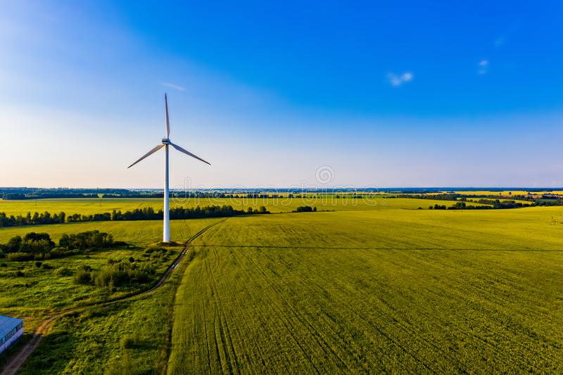 Amazing landscape in summer. Blue sky above farmlands. Producing electricity concept. Wind turbine in field. Amazing landscape in the summer. Blue sky above stock images