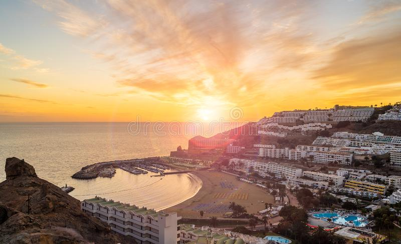Amazing landscape with sunset at Puerto Rico. Village and beach on Gran Canaria, Spain royalty free stock photos