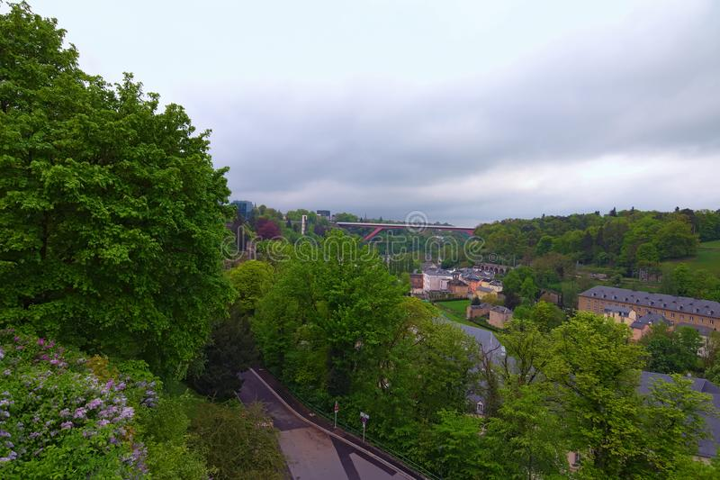 Amazing landscape view of old town Luxembourg City from top view. Grand Duchess Charlotte Bridge at the background. royalty free stock photo