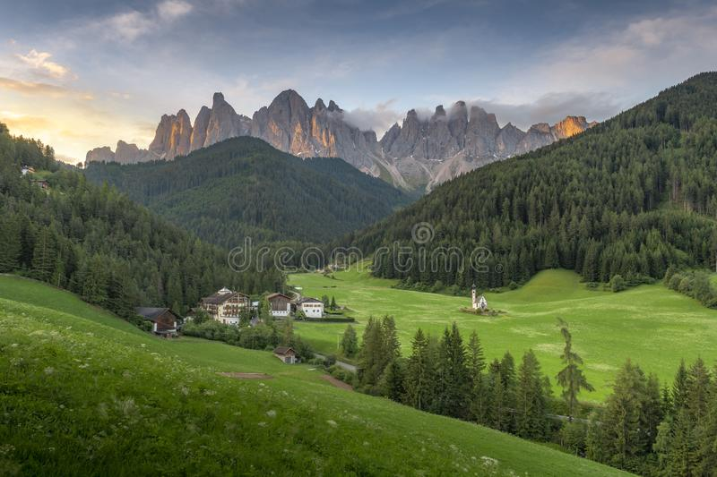 Amazing landscapes view of green hill and mountain with blue sky on sunrise morning from Dolomites, Italy. Amazing landscapes view of green hill and mountain stock photos