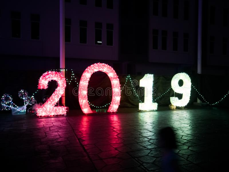2019 Light in numbers for happy new year at night time to celebrate special holiday occasion, Christmas party, diwali, independent royalty free stock photo