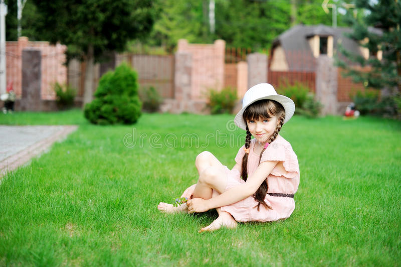 Amazing little girl in pink dress and white hat stock photos