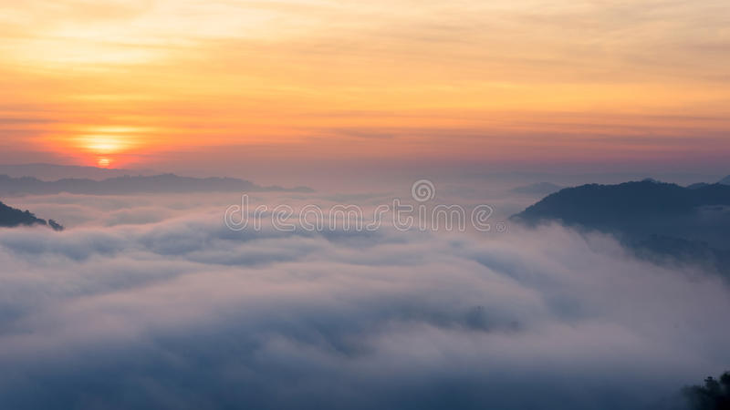 Amazing mist moving over the nature mountains stock photography