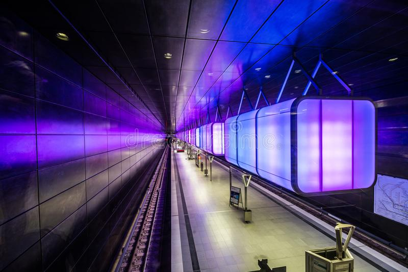 Subway station with light blue lights at University on the Speicherstadt area in Hamburg. royalty free stock photography