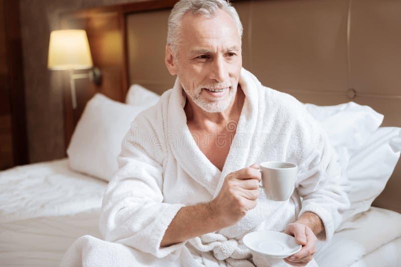 Glad senior man starting new morning stock image
