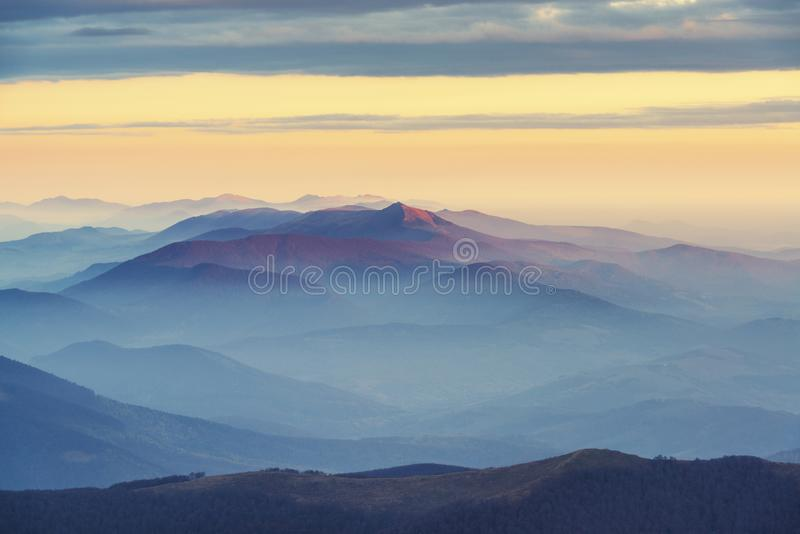 Amazing morning mountain view in blue and pink tonality. Sunrise in Carpathian mountains royalty free stock photography