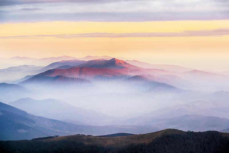 Amazing morning mountain view in blue and pink tonality. Sunrise in Carpathian mountains stock images