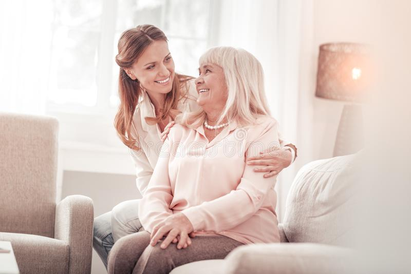 Amazing mother and daughter smiling tenderly to each other stock photos