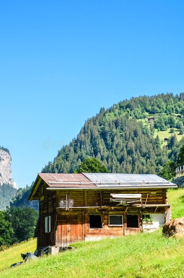 Amazing mountain chalet near Lauterbrunnen in Swiss Alps. Stunning Alpine landscape in summer season. Sunny day, green hills. Hut royalty free stock photo