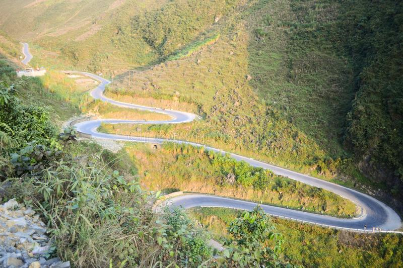 Amazing mountain pass road called Nine Ramps or Doc Chin Khoanh in Vietnamese near Van Karst geological park. Vietnam royalty free stock photography