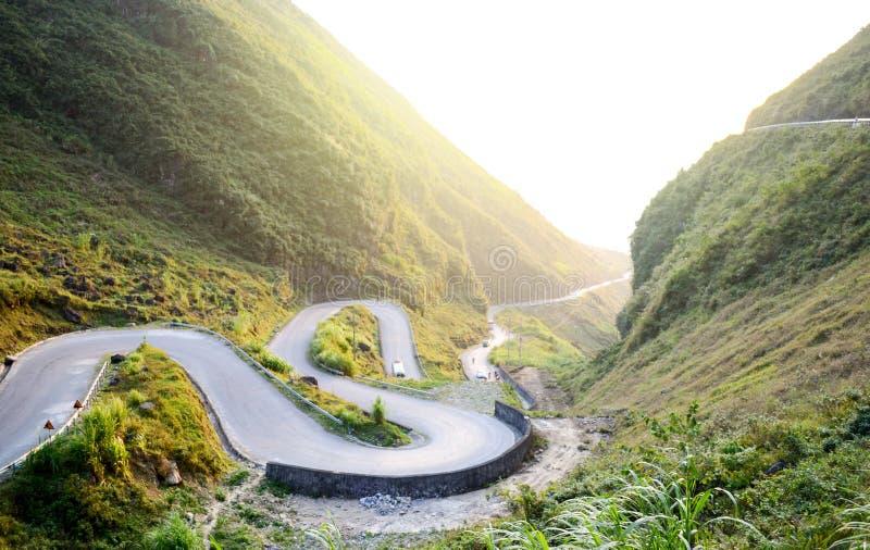 Amazing mountain pass road called Nine Ramps or Doc Chin Khoanh in Vietnamese near Van Karst geological park. Vietnam royalty free stock photo