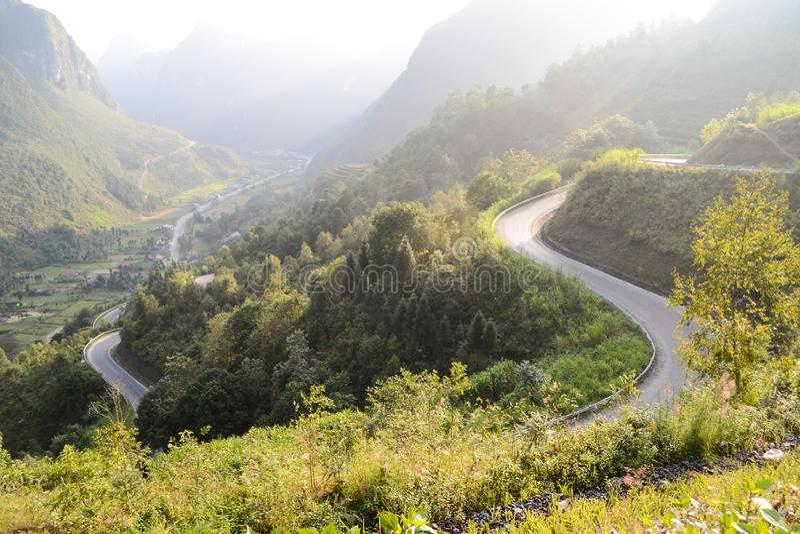 Amazing mountain pass road called Nine Ramps or Doc Chin Khoanh in Vietnamese near Van Karst geological park. Vietnam stock image