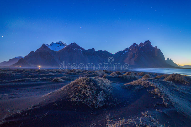 The amazing mountain under the night sky in Iceland royalty free stock image