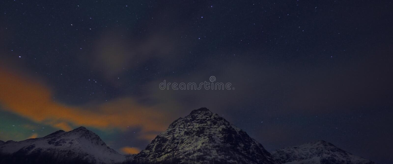 Amazing multicolored Aurora Borealis also know as Northern Lights in the night sky over Lofoten landscape, Norway, Scandinavia. stock photos