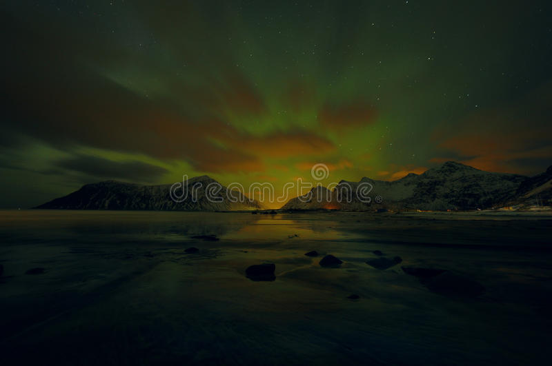 Amazing multicolored Aurora Borealis also know as Northern Lights in the night sky over Lofoten landscape, Norway, Scandinavia. royalty free stock images