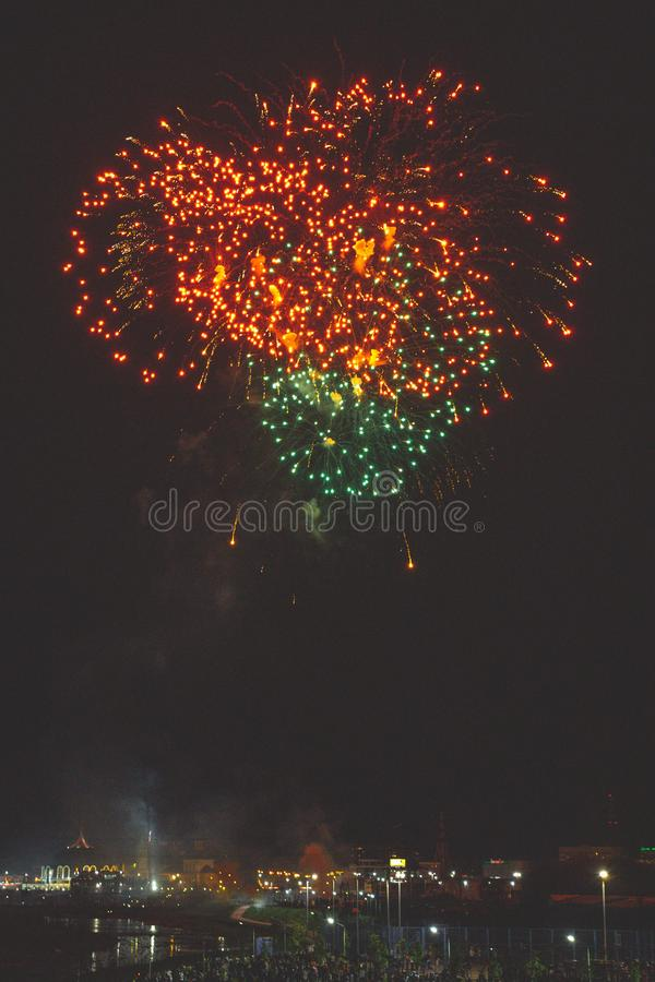Beautiful night fireworks show in the city royalty free stock photography