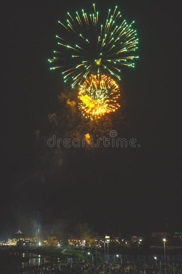 Beautiful night fireworks show in the city stock image