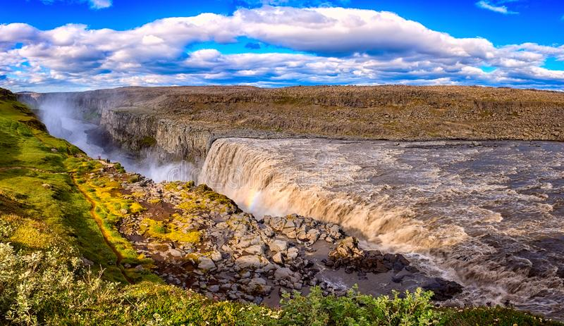 Amazing nature landscape, stunning Dettifoss waterfall with rocky canyon and blue cloudy sky Iceland. Scenic panoramic aerial view royalty free stock photo