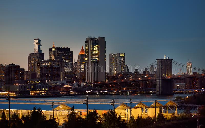 Amazing New York City Manhattan skyline panorama view over Hudson River at dusk. Brooklyn bridge stock photos
