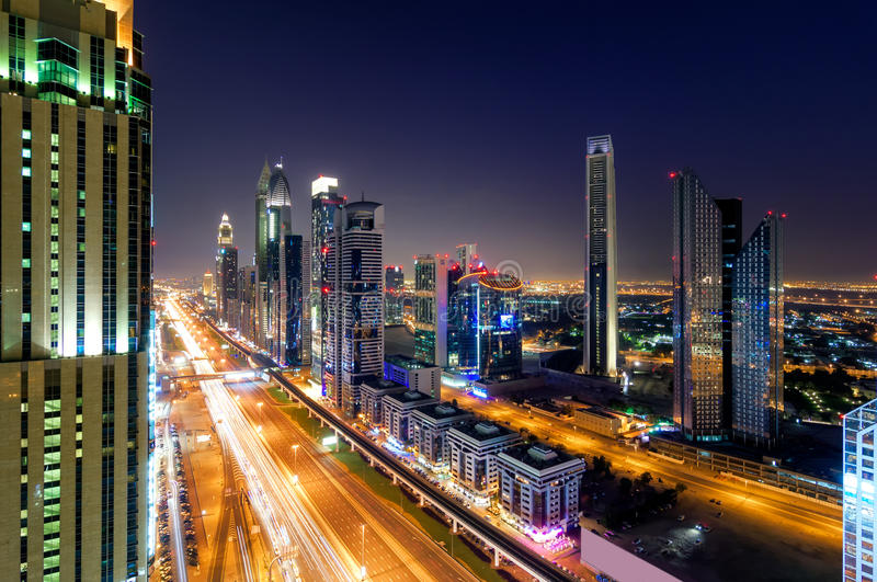 Amazing night dubai downtown skyline, Dubai, United Arab Emirates. Amazing night dubai downtown skyline with tallest skyscrapers and traffic jam during rush hour stock photos