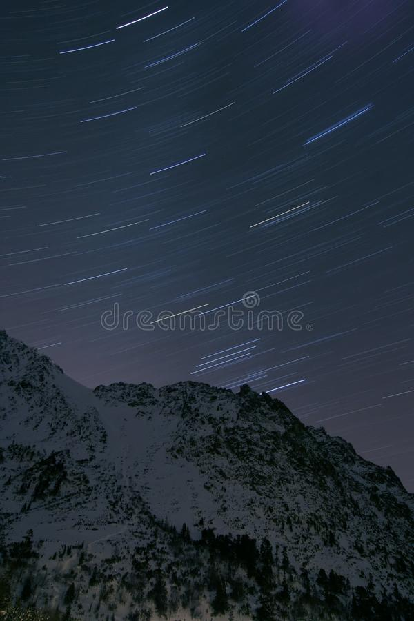 Amazing night sky in rocky mountains stock images