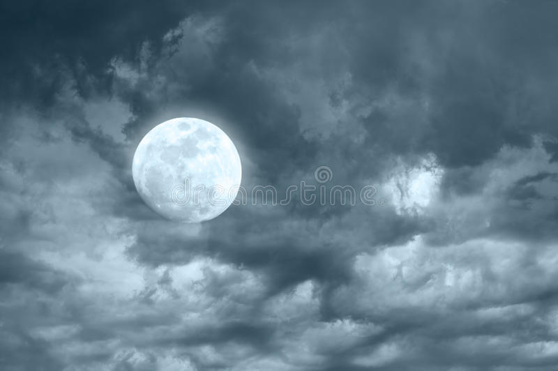 Amazing night sky with shining full moon. And dramatic clouds royalty free stock photos