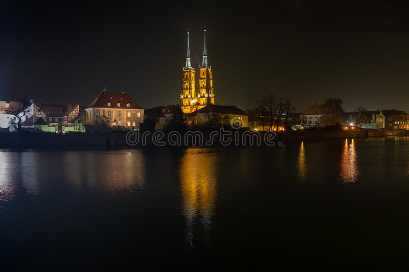 Amazing night view of the Cathedral of St. John the Baptist reflected in Oder river. Ostrow Tumski district. Wroclaw royalty free stock image