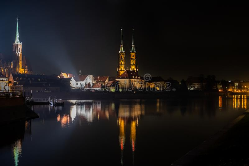 Amazing night view of the Cathedral of St. John the Baptist reflected in Oder river. Ostrow Tumski district. Wroclaw. Poland royalty free stock photo