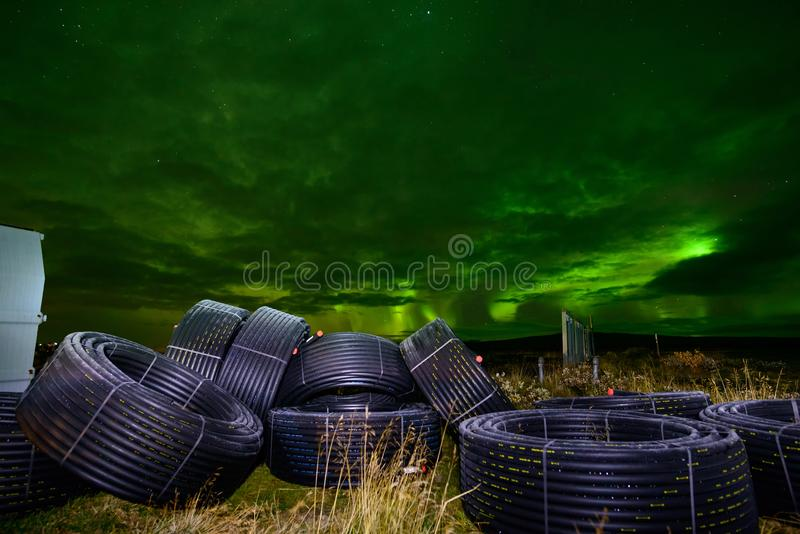 Amazing Northern Lights over the Iceland sky. The bright dancing lights of the Aurora Borealis. Green light in beautiful nightscape royalty free stock image