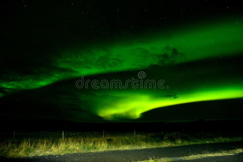 Amazing Northern Lights over the Iceland sky.Beautiful Aurora Borealis. Amazing Northern Lights over the Iceland sky. The bright dancing lights of the Aurora royalty free stock photo