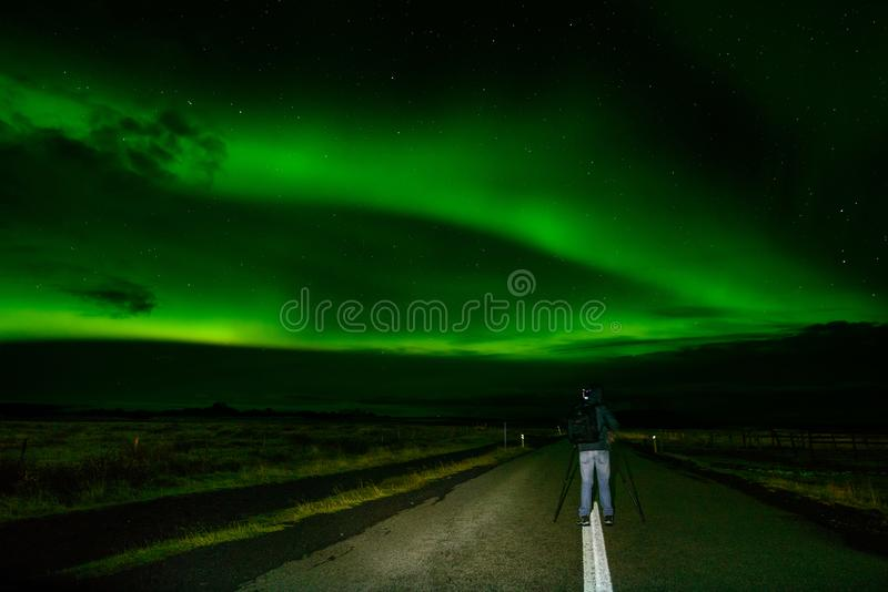 Amazing Northern Lights over the Iceland sky. The bright dancing lights of the Aurora Borealis. Green light in beautiful nightscape stock photo