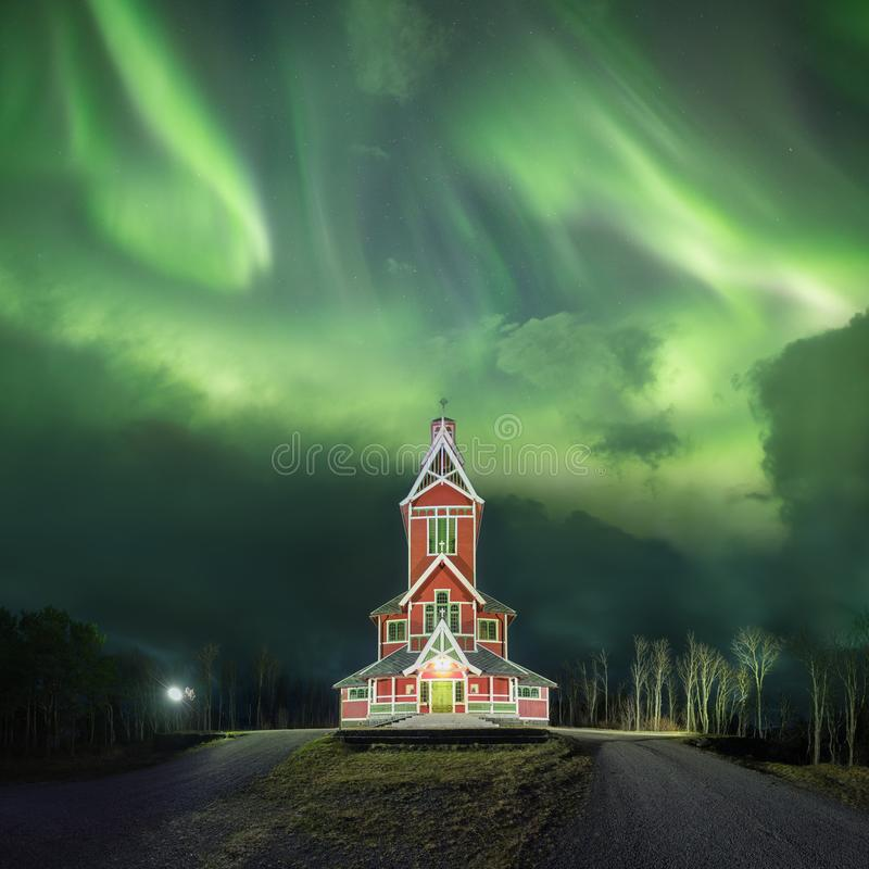 Northern lights in Lofoten islands, Norway. Green Aurora borealis. Starry sky with polar lights. Night winter landscape in night. Amazing old church. Northern stock photos
