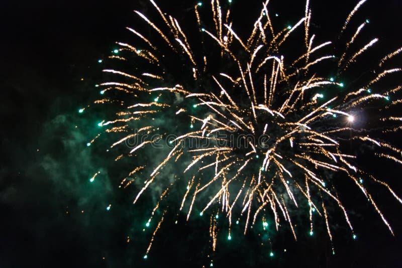 Amazing orange fireworks on dark sky with green smoke royalty free stock photos