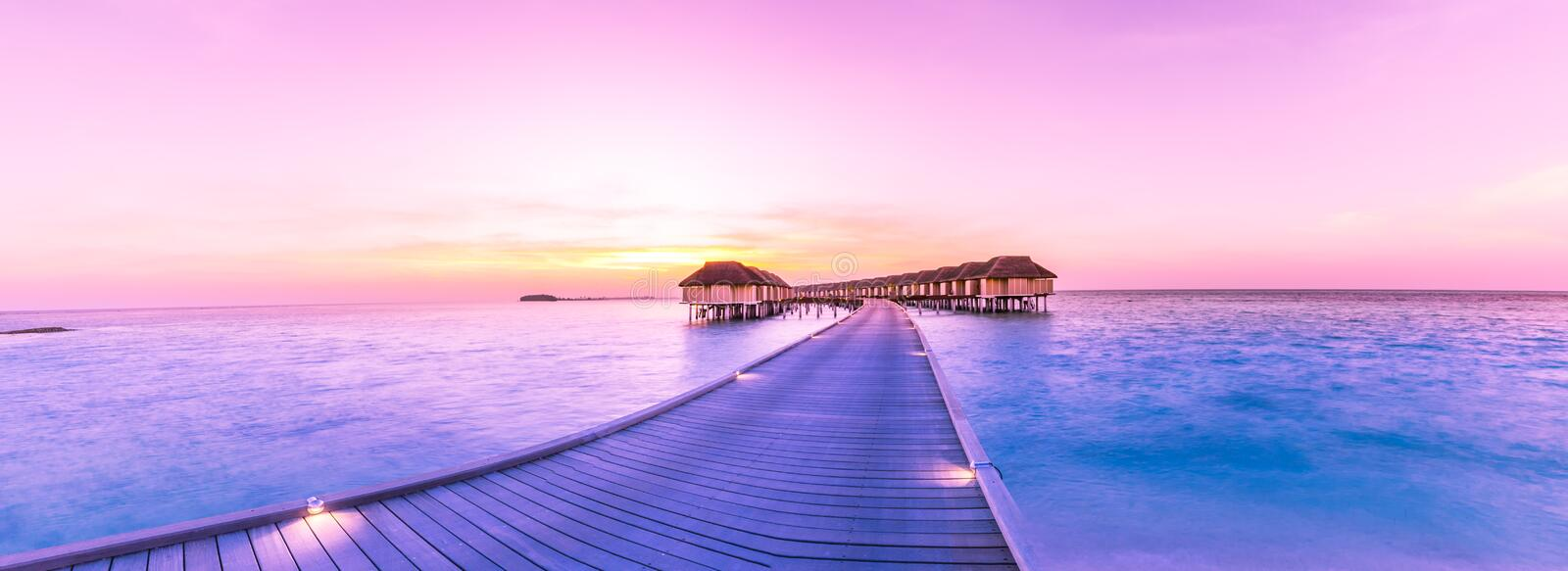 Amazing panorama beach landscape. Maldives sunset seascape view. Horizon with sea and sky. Tranquil scenery, tourism and travel stock photos