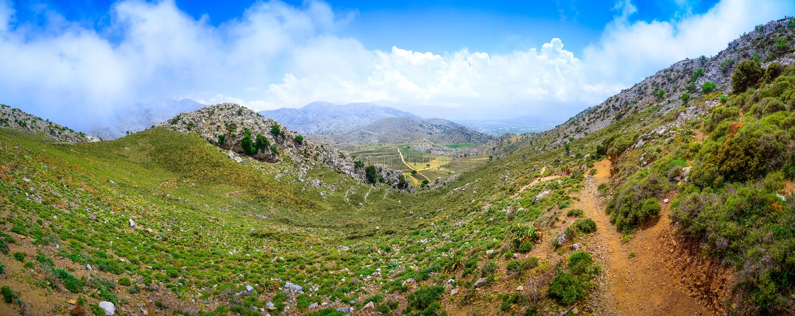 Amazing panorama of rough wild mountains, grass, cloudy blue sky, Lasithi, Crete. Greece stock images