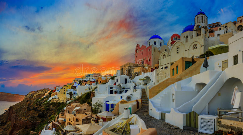 Amazing panorama sunset view with white houses in Oia village on royalty free stock photo