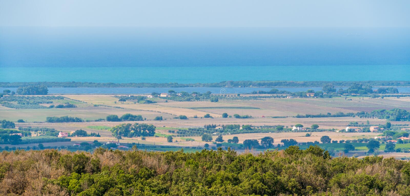 Amazing panorama with the Tuscany coastline, from the Capalbio city walls. Province of Grosseto, Italy. stock photo