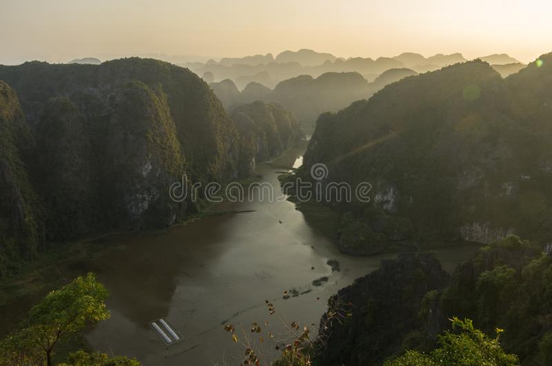 Amazing panorama view of limestone rocks and mountaintops from Hang Mua Temple at evening. Ninh Binh, Vietnam. Travel landscapes. And destinations background stock photography