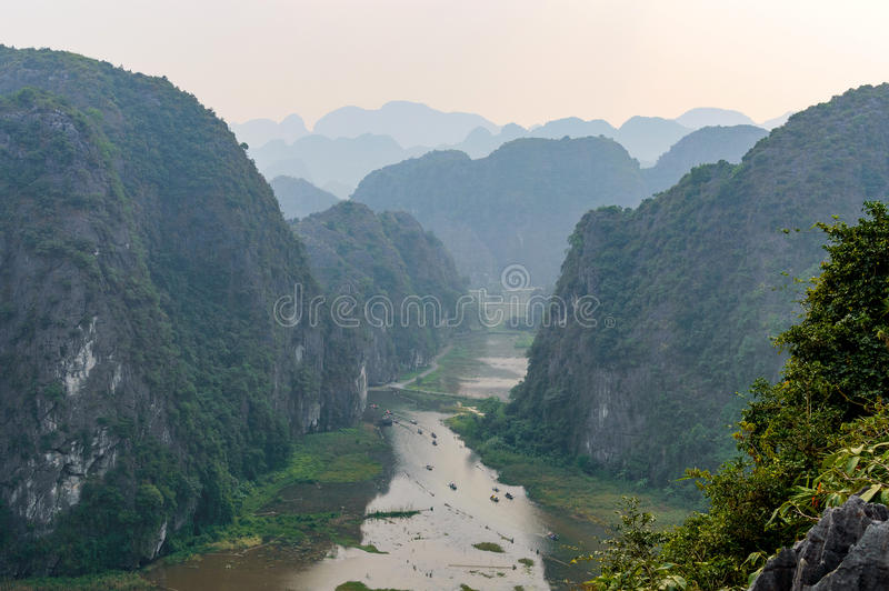 Amazing panorama view of the rice fields, limestone rocks and mountaintop Pagoda from Hang Mua Temple viewpoint. royalty free stock image