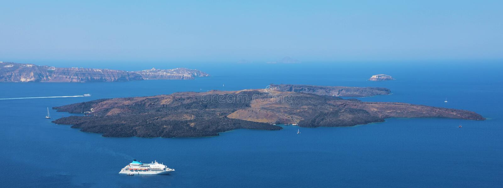 Amazing panoramic banner view from Santorini Island with the caldera of volcano and cruise ships in the Mediterranean sea, Greece stock photos