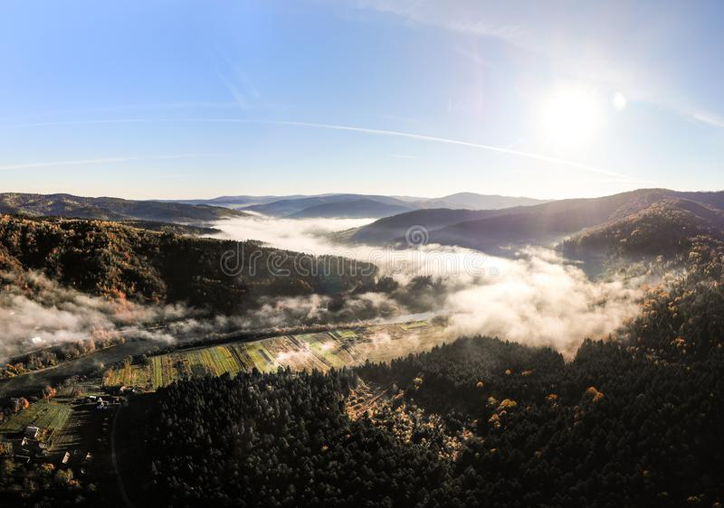 Amazing panoramic landscape of Carpathian Mountains, magical beauty of ukrainian autumn mountains and forests. Morning fog spreads royalty free stock photography
