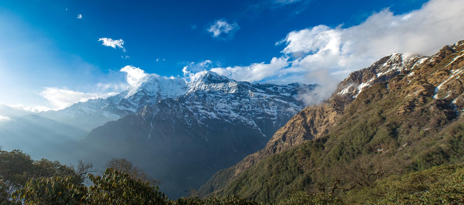 Amazing panoramic landscape view of beautiful Himalaya mountains covered with snow at Mardi Himal trekking area. In Nepal stock photo