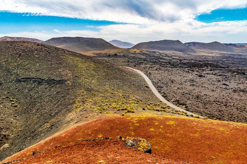 Amazing panoramic landscape of volcano craters in Timanfaya national park. Popular touristic attraction in Lanzarote island, stock photography