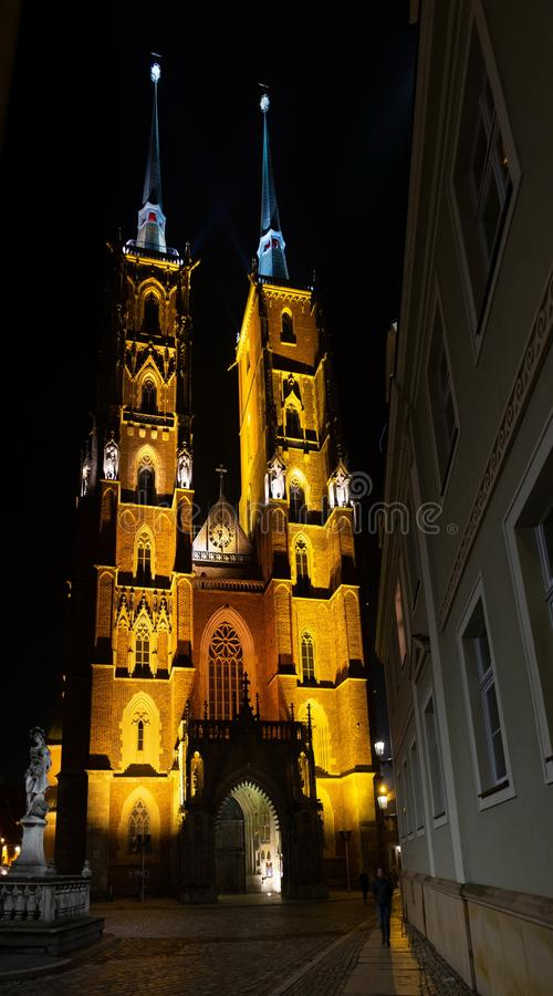 Amazing panoramic night view on beautiful illuminated Cathedral of St. John the Baptist. Ostrow Tumski district. Wroclaw. Poland royalty free stock photo