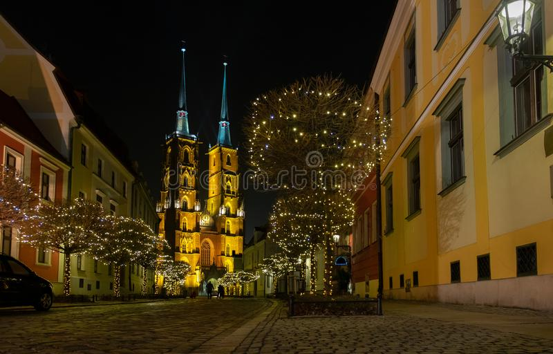 Amazing panoramic night view on beautiful illuminated Cathedral of St. John the Baptist. Ostrow Tumski district. Wroclaw. Poland stock image