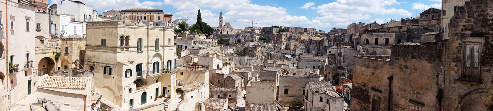 Amazing panoramic view from a balcony of typical stones Sassi di Matera and church of Matera UNESCO European Capital of Culture stock images