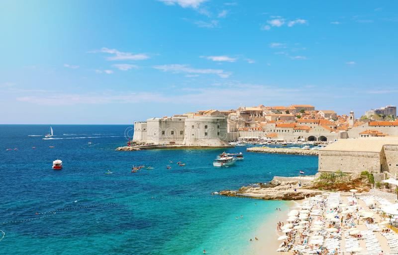Amazing panoramic view of the old port of Dubrovnik with medieval fortifications on Adriatic Sea and Banje beach, Croatia, Europe royalty free stock image
