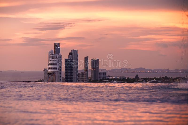 Amazing pink sunrise at infinity pool, Pattaya, Thailand royalty free stock photography