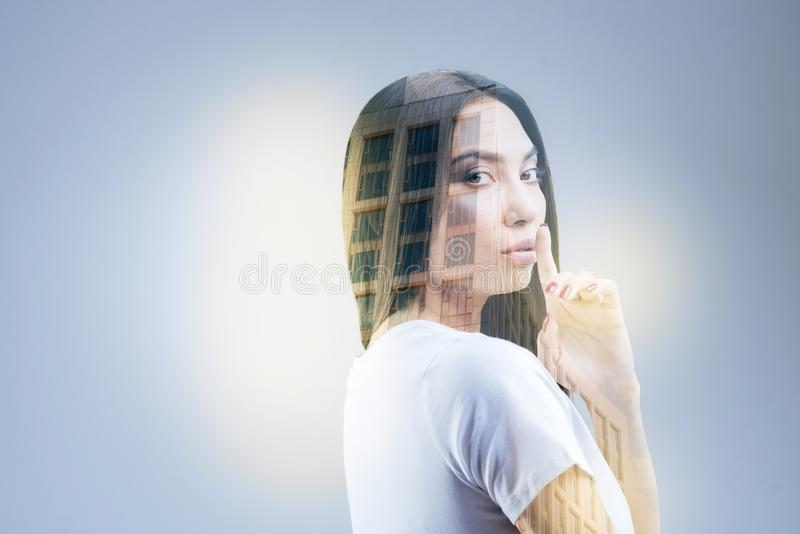 Amazing pleasant woman searching muse. Great idea. Pensive attractive calm woman sharing her secrets while standing on the isolated background and planing finger stock image