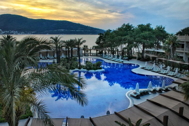 Amazing pool and sunset from Bodrum, Turkey. Blue, swimming, nature, view, hotel, vacation, resort, palm, trees, holiday stock photos